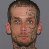 Does This Guy With An 'Unpredictable' Tattoo On His Face Look Like a Guy Who Was Caught Red Handed Breaking Into Cars?